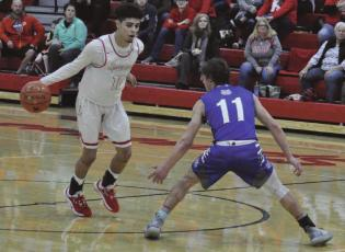 SENIOR DIONTE MARQUEZ, seen here dribbling during a late January game at Richmond High School, has been named a Class 3 all-state basketball selection.