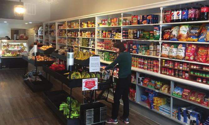 RUN BY John Paul Coonrod, Great Scott Community Market fits inside an old shoe store. DANA CRONIN | Harvest Public Media