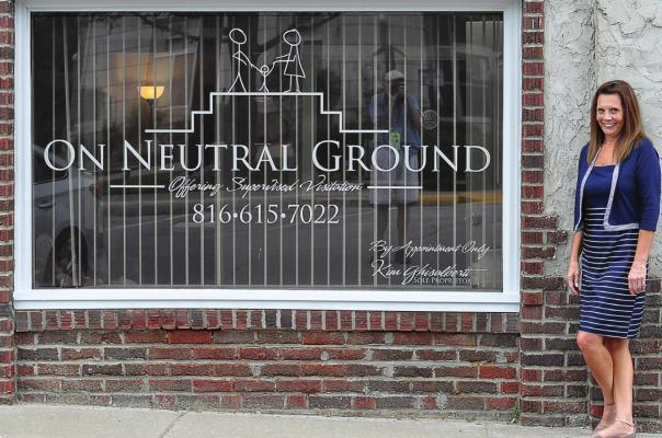 A PICTURE WINDOW with a picture that portrays the purpose of On Neutral Ground is shown off by the business owner, Kim Ghisalberti, Richmond. SHAWN RONEY | Staff
