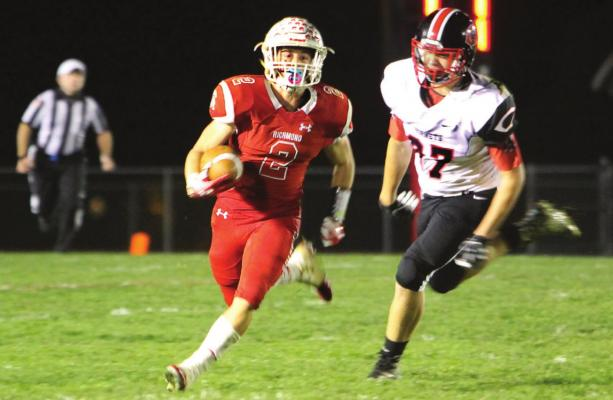 JUNIOR wide receiver Layne Cavanah gains first-down yardage on a night when he scores three touchdowns and sets up Richmond for a fourth in the team's 62-35 playoff win against Chillicothe.