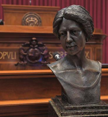 THIS BRONZE BUST of Annie White Baxter, the nation's and Missouri's first female county clerk, is viewed in the House chamber. The bust has since been placed on display in the Capitol Rotunda's Hall of Famous Missourians. TIM BROMMEL | House Communications