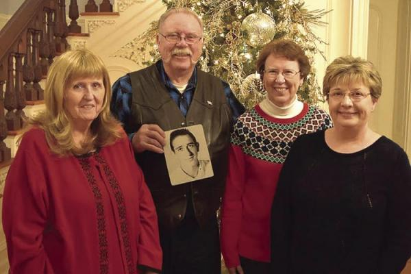 THE SHARP SIBLINGS reunite after being apart for 69 years. From left are Annette Gaiser; Dan Garnett, who holds a photo of their late brother, John; Lisa Pierce; and half-sister, Brenda Hamm. They meet at Linwood Lawn in Lexington for three days to get acquainted.
