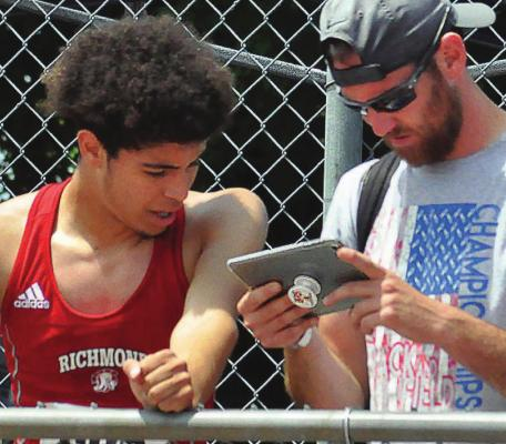 RICHMOND student-athlete Dionte Marquez, reviewing his technique with jumpers coach Jacob Swope at the 2019 Class 3 state track and field meet SHAWN RONEY | Staff in Columbia, looks to continue his athletic career at the University of Central Missouri in Warrensburg. Swope plans to follow Marquez's career at UCM.