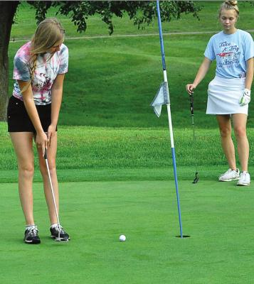 HANNAH NORRIS practices her putting Aug. 14 at Shirkey Golf Course. SHAWN RONEY | Staff