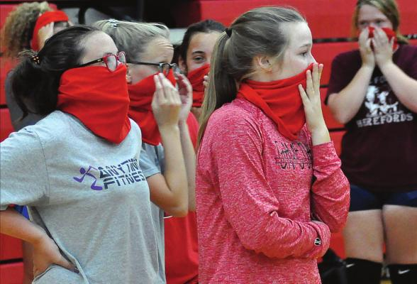 THE RICHMOND VOLLEYBALLERS adapt to sports in a COVID-19 world, donning their gaiter masks during a break between early-morning practice reps Aug. 21 at Sunrise Elementary School. SHAWN RONEY | Staff