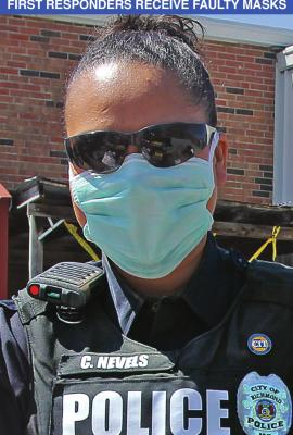 RICHMOND Police Officer Chassity Nevels wears a facemask to give out commodities. Masks are expected to help keep wearers from transmitting or being infected by COVID-19, but the state sent emergency management agencies faulty masks. J.C. VENTIMIGLIA | Staff