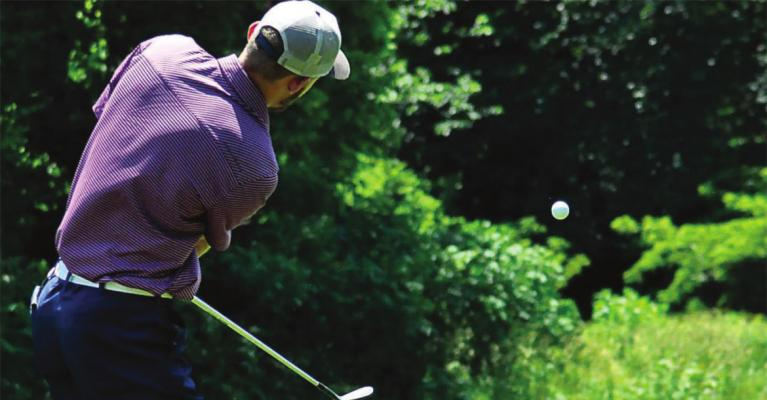 DYLAN COMSTOCK gets some loft on his golf ball Monday at Drumm Farm Golf Course in Independence. SHAWN RONEY | Staff