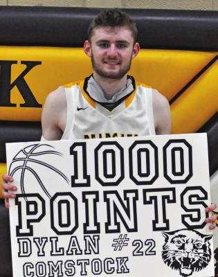 ORRICK SENIOR Dylan Comstock enjoys achieving a career milestone Tuesday after the Bearcats' 64- 41 Class 1 District 13 Tournament victory over visiting Norborne. SHAWN RONEY | Staff