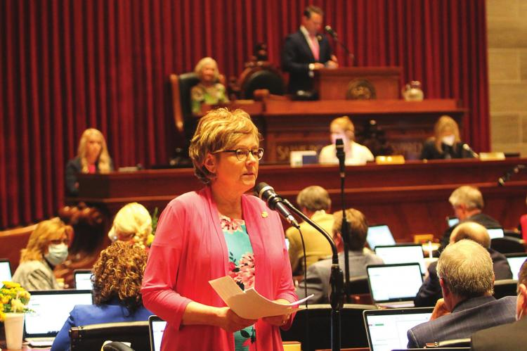 ON THE FLOOR of the Missouri House, Rep. Peggy McGaugh listens to an apology from Rep. Dan Shaul.