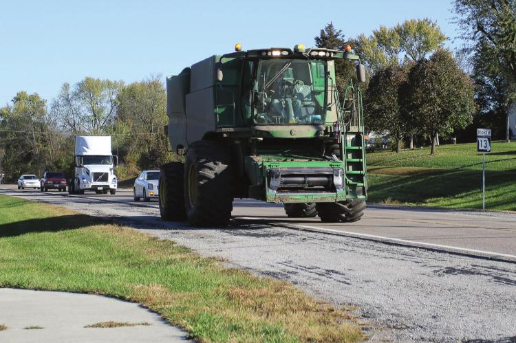 MUCH OF THE HARVEST is in, but work remains. Grain must be hauled along roads throughout the area. Along Highway 13, vehicles move slowly in a line behind farm equipment. The Missouri Coalition for Roadway Safety reminds drivers to be aware of slow-moving combines and other farm equipment. J.C. VENTIMIGLIA | Staff