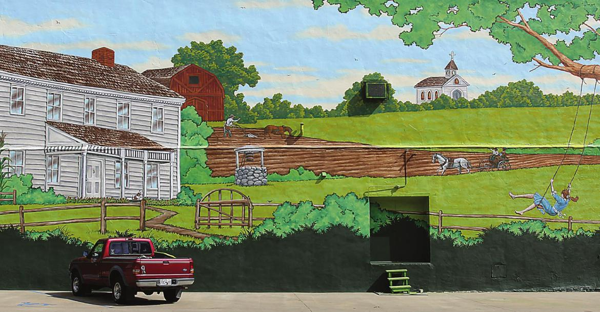 THOSE ENTERING downtown Richmond from the west will find a new mural that depicts a scene from Ray County history. The Ray County Community Arts Association pays for the mural and seeks donations. J.C. VENTIMIGLIA | Staff