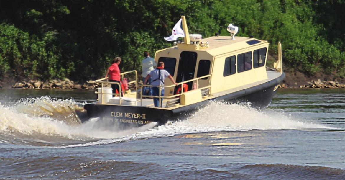 THE CLEM MILLER II takes off from Lexington to tour river repair work.