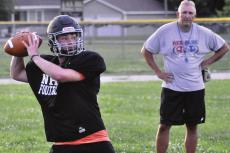 WITH LONGTIME COACH Kirk Thacker watching, Norborne Hardin-Central quarterback Brayden Schick rears back to throw a wide receiver screen pass Monday at Norborne. SHAWN RONEY | Staff