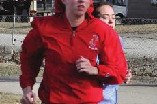 CARLY THACKER, seen training March 5 in her red windbreaker, hopes to have the chance to defend her Class 1 state girls 300-meter low hurdles title.