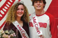SOPHIA FARNAN and Wyatt Marshall sport their crowns and sashes for a Feb. 5 photo op after Richmond's varsity court warming basketball games. SHAWN RONEY | Staff